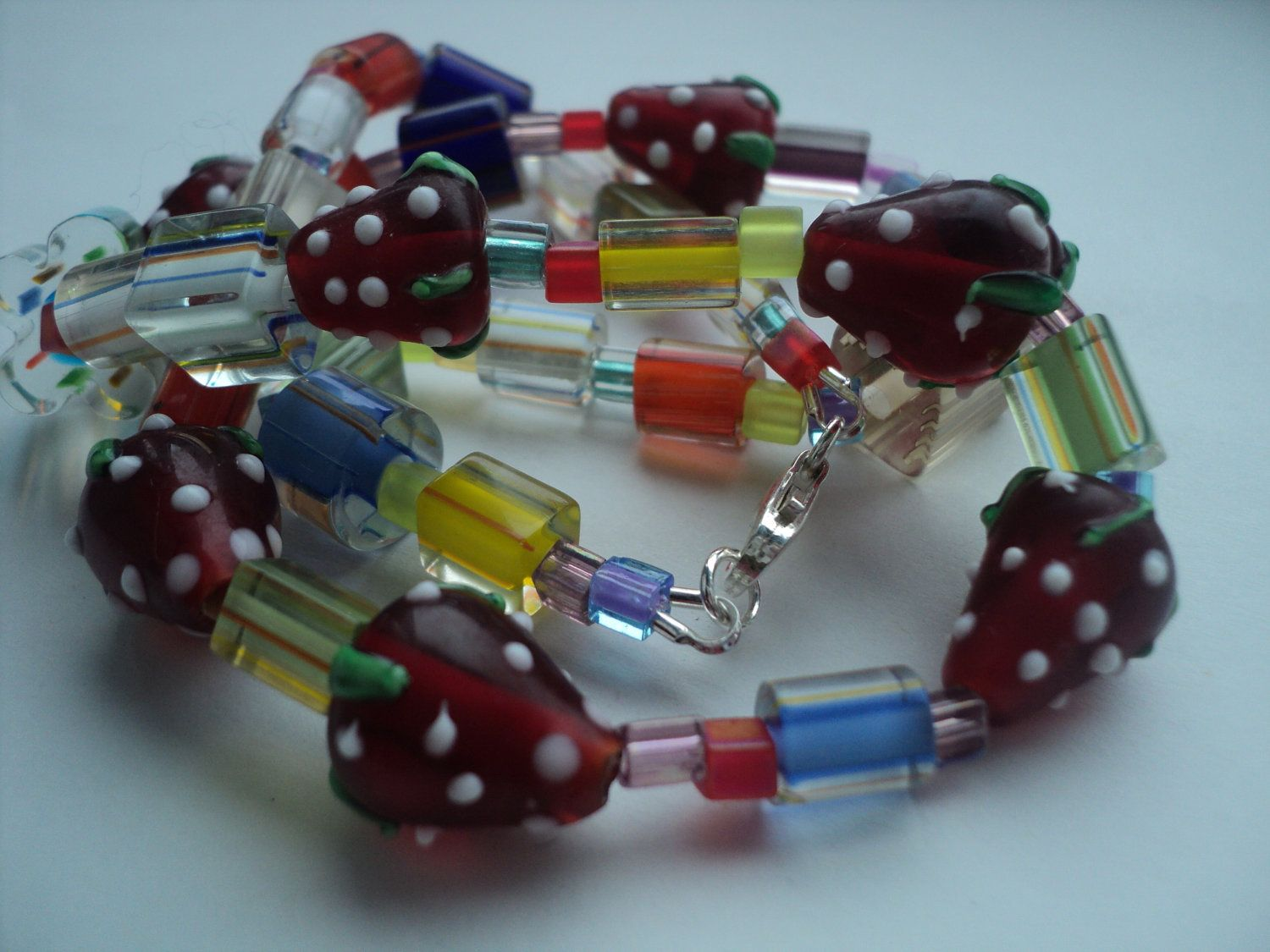 Strawberry - glass bead necklace with sterling silver clasp. £10.00, via Etsy.