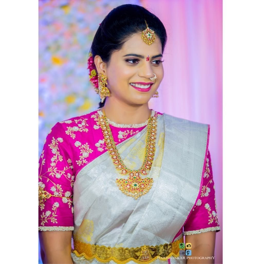 e16de25f556800 Gorgeous bride wearing traditional Mango haram 💖.Photography   harishankar photography Bridal Blouse Designs