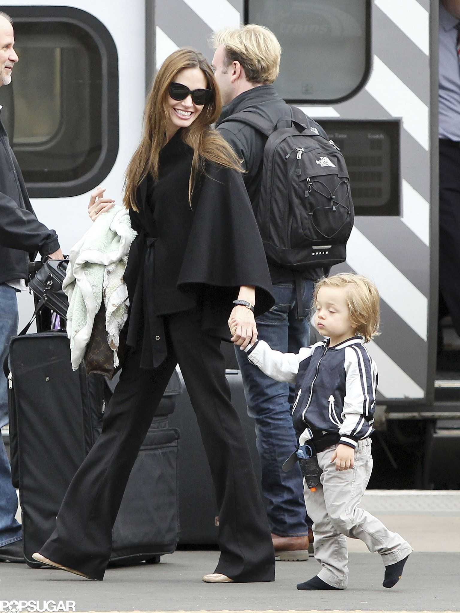 Angelina Jolie held Knox's hand in Scotland in August 2011.
