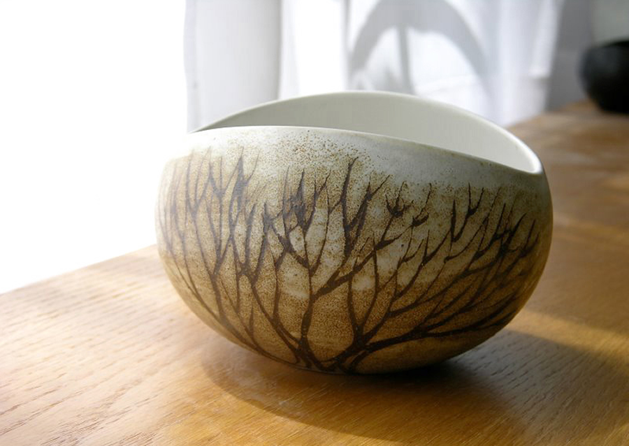 Classic Stoneware Salad Bowl design with orbiting curves by mid-century ceramic designer, Weston Neil Andersen. Middle size in a series of descending sizes