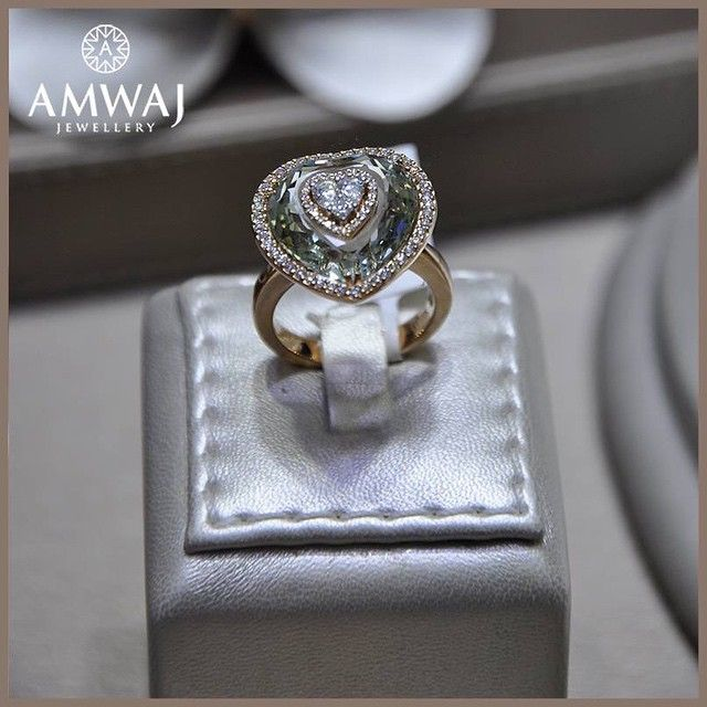 A distinguished and soft combination of  green topaz and diamond heart ring from Amwaj Jewellery.  #jewelry #middleeast #beauty #luxury #uae #abudhabi #ksa #love #diamonds #wow #beautiful #happy #jws #family #women #pearls #dubai #style #russia #jewelry #model #gift #heart  #vip #bahrain #ring #watch