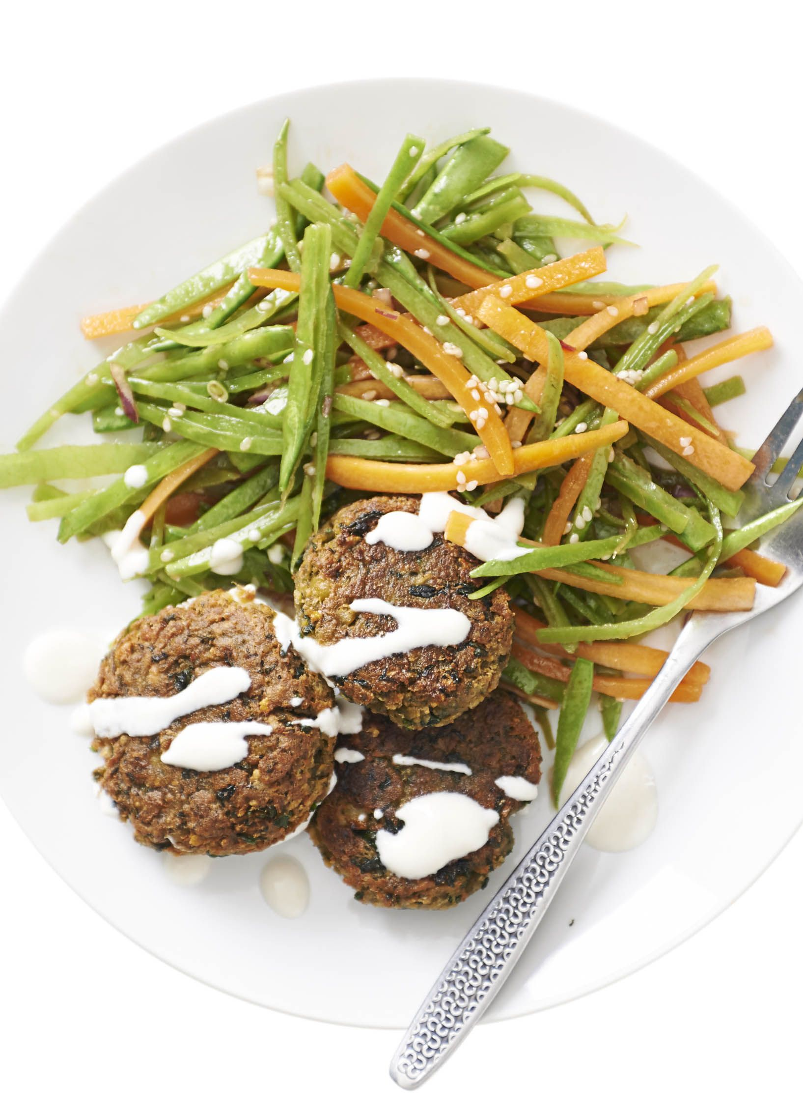 Spinach falafel with sesame mange tout salad: Our low-fat and low-calorie falafel takes a spinach twist in this easy recipe. Accompany your homemade falafel with a fresh mange tout salad for a healthy, feel-good meal.
