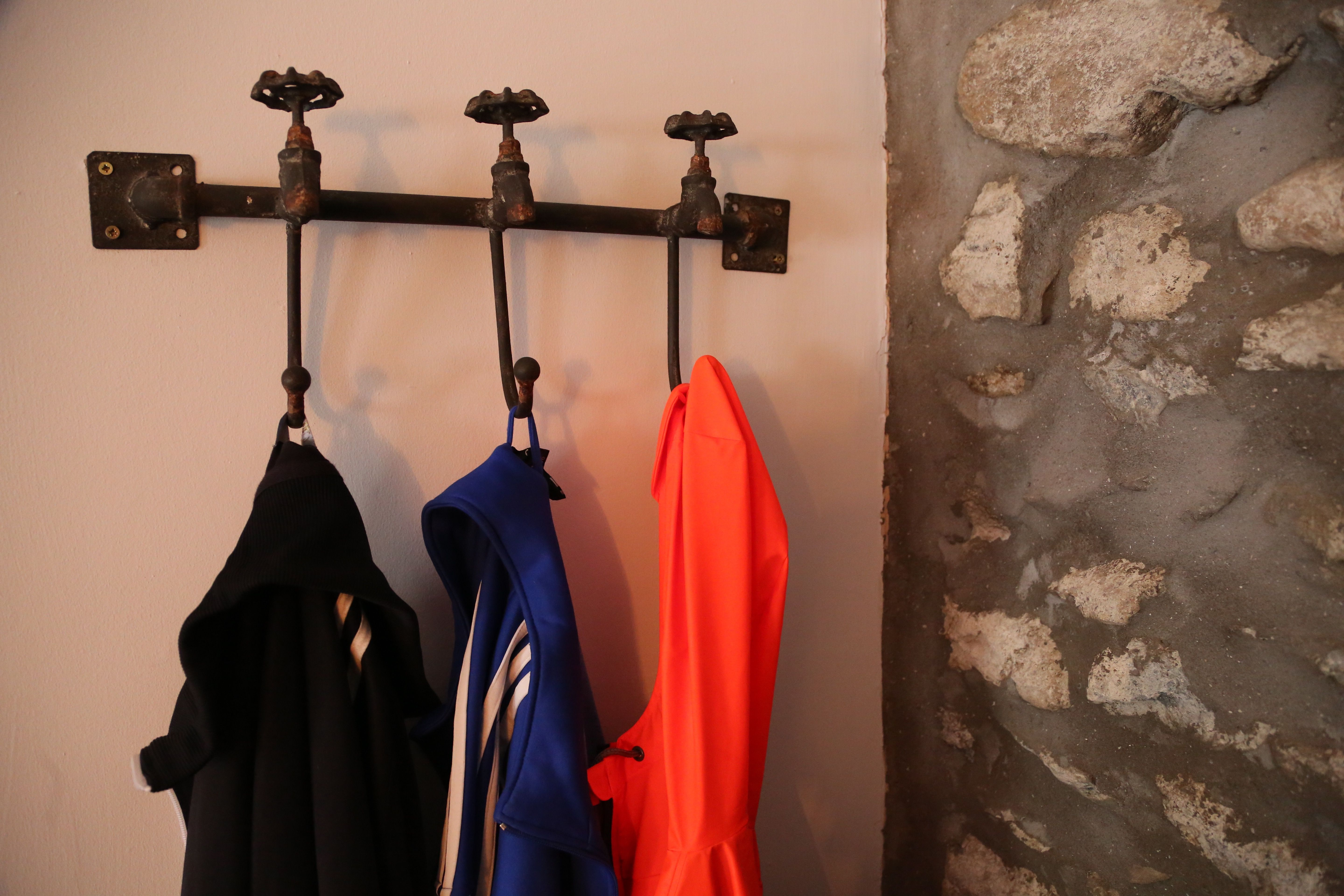 industrial taps up-cycled into a clothes hanger