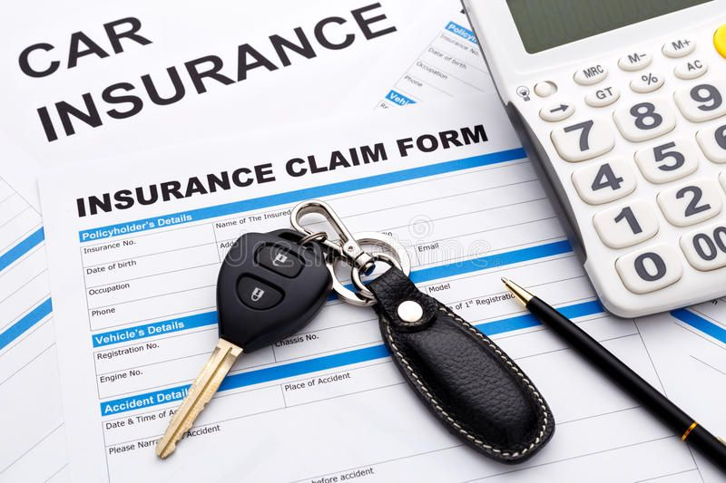 Car insurance claim concept with car key and calculator