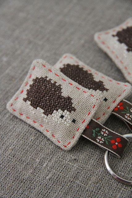 Cross-stitched hedgehog by Katia Donohoe, via Flickr