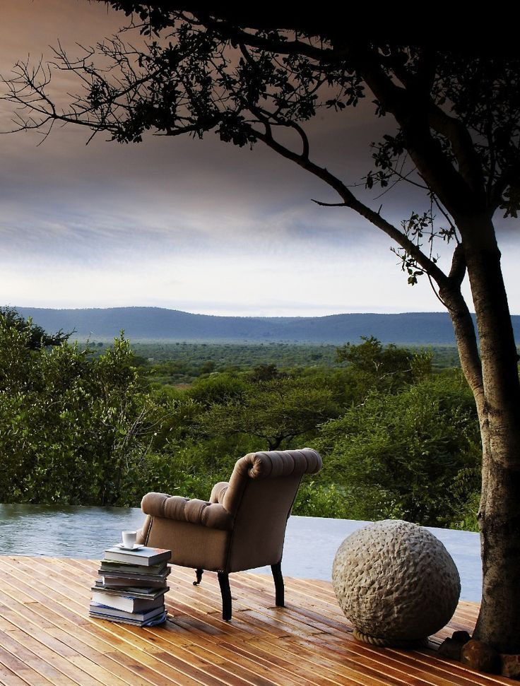 Molori Safari Lodge - Bostwana, Africa, I wouldn't mind sitting in this chair and reading one of those books