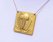 My favorite pre-historic creature! I must have this - CNC sculpted wood trilobite necklace painted gold