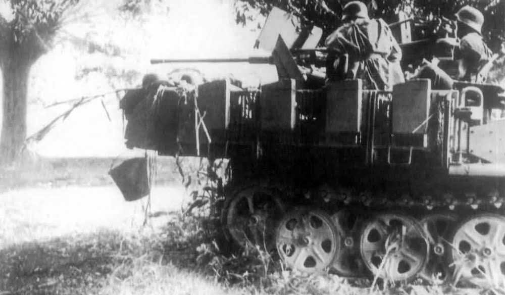 Soldiers of the 25th Panzer Division fired its 20 mm anti-aircraft gun. mounted…