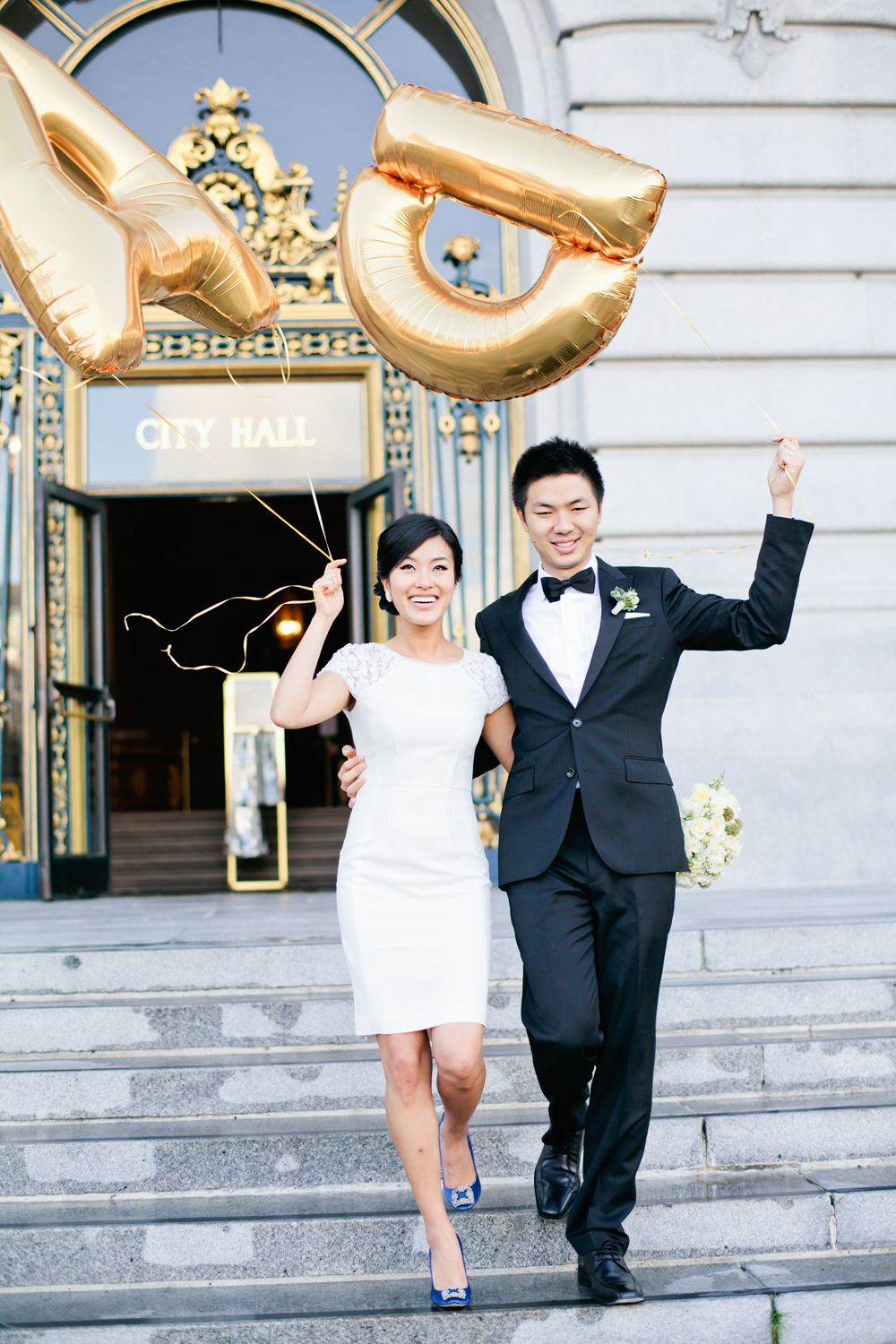 Couple with gold monogram balloons couples short wedding dresses