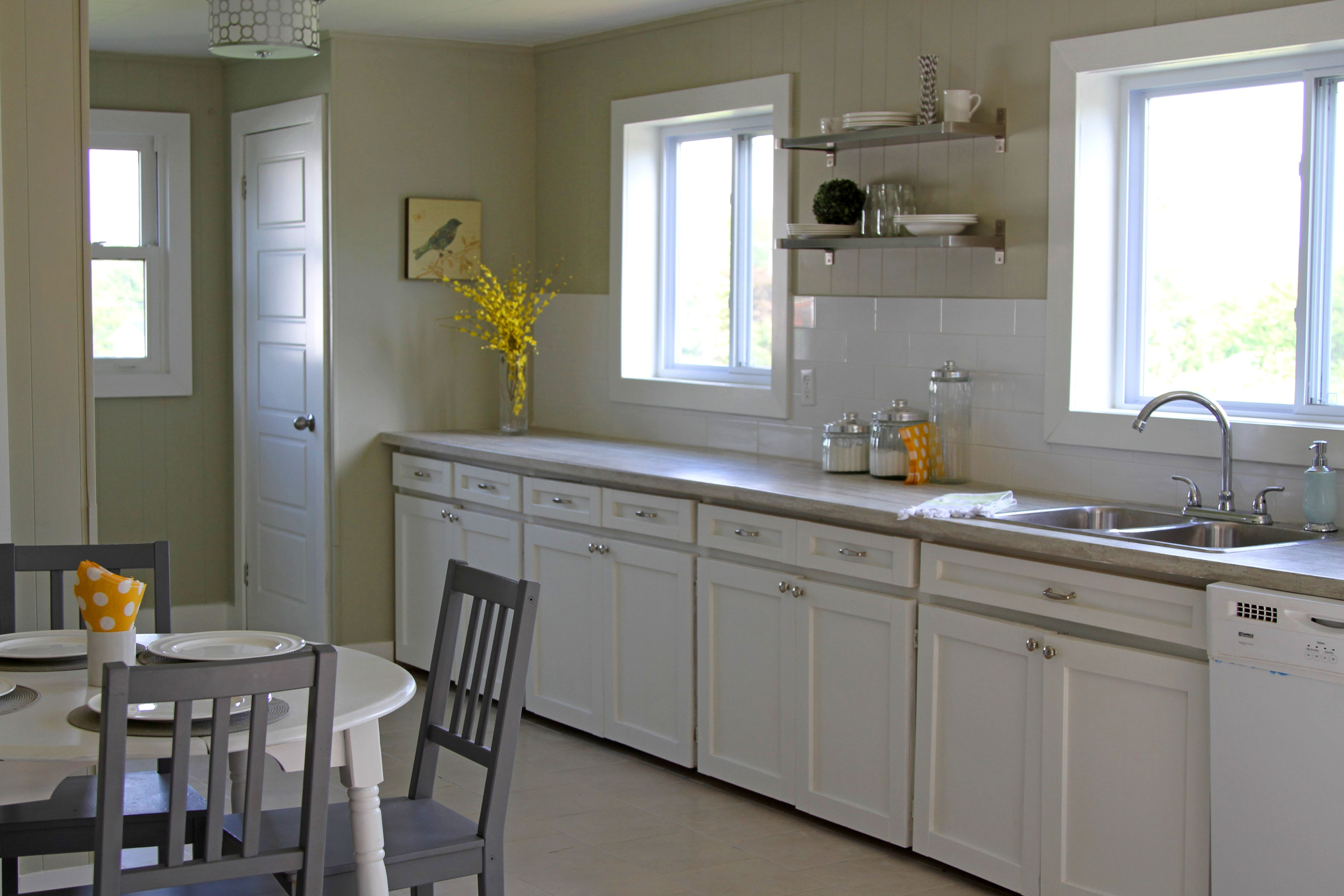 Simple Modern Renovated Kitchen Remove Top Cabinets Glue The Outside Of Bottom Cabinets With Slats Caulk Paint W Home Kitchens Kitchen Remodel Ikea Shelves