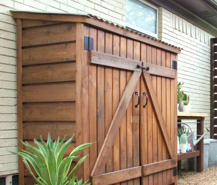 Tool Shed with Stain and Cedar Trim inside the carport for