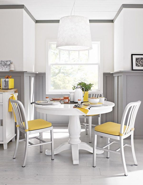 White Pedestal Table Gray Walls Yellow Accents