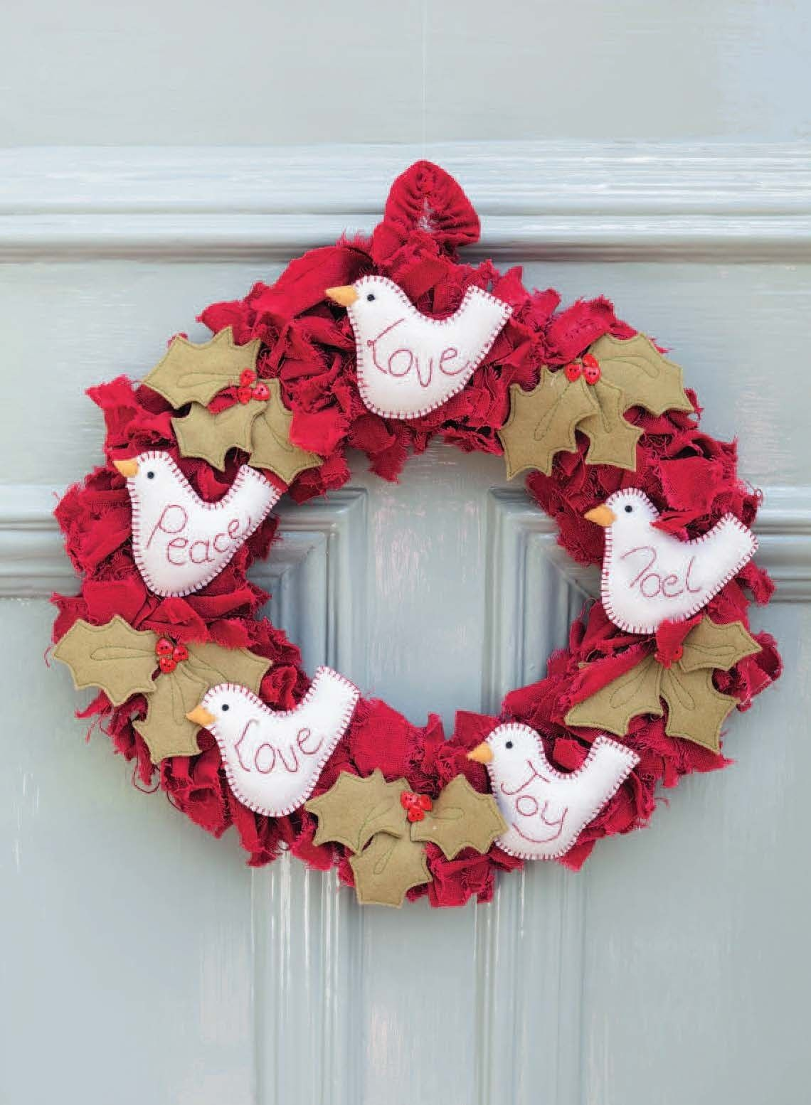 This traditionally styled shaggy wreath decorated with doves