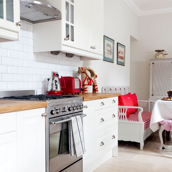 White Country Kitchen With Scandi Style Furniture The Fresh Units And Swedish In This Are Teamed Vibrant Red Accessories