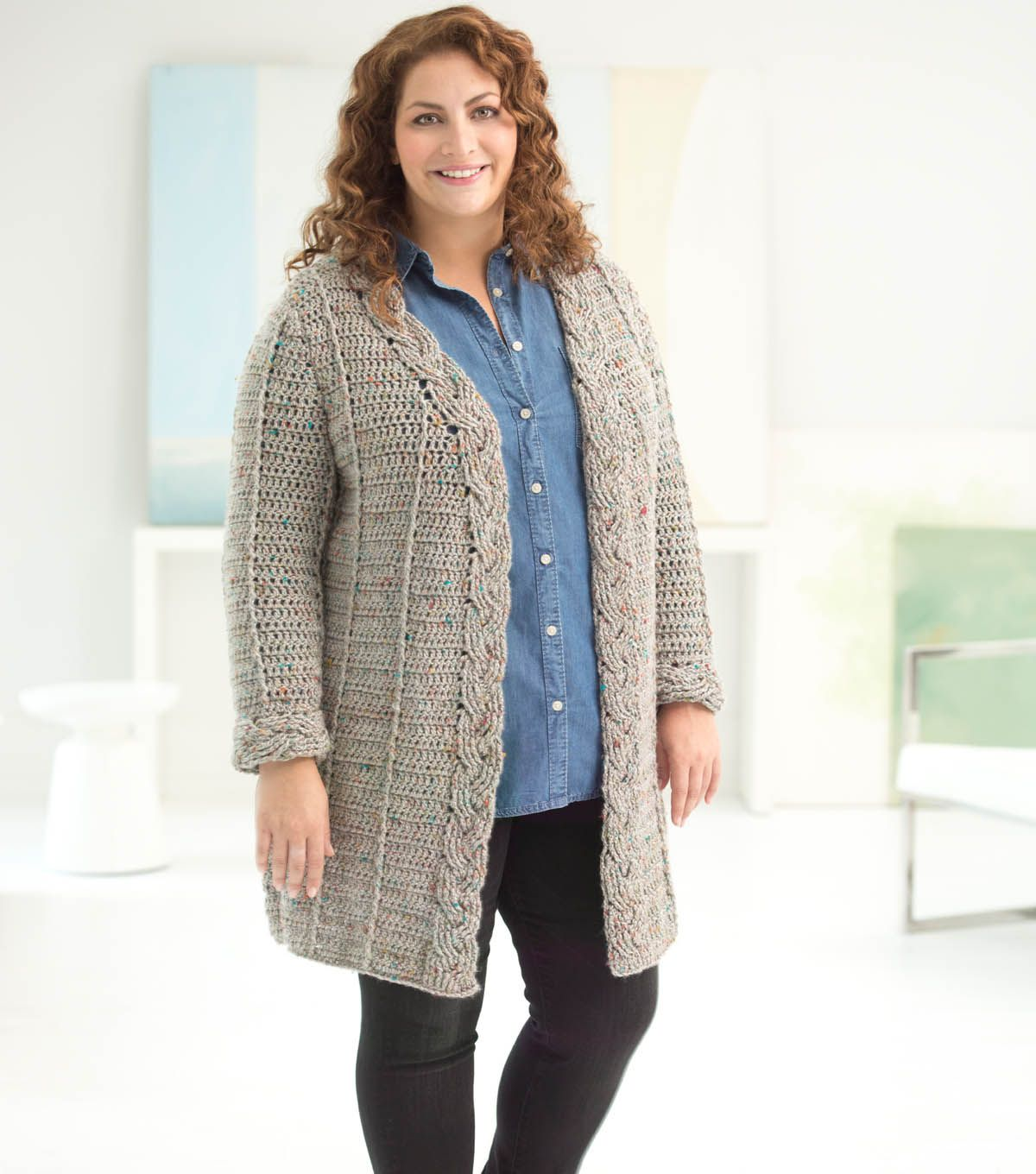 5d2dd8e865870 Learn how to make a crochet cabled cardigan with this free pattern ...