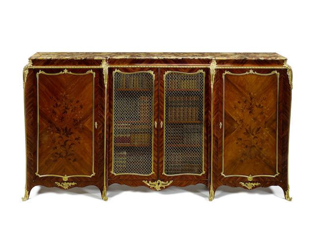 A large French Louis XV style ormolu mounted kingwood, satiné and