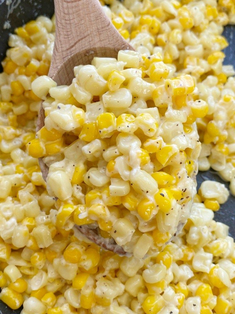 Side Dish Recipes | Corn Recipes | Honey Butter Skillet Corn is an easy 15 minute side dish with frozen corn, honey, butter, and cream cheese! So creamy, sweet, and delicious.