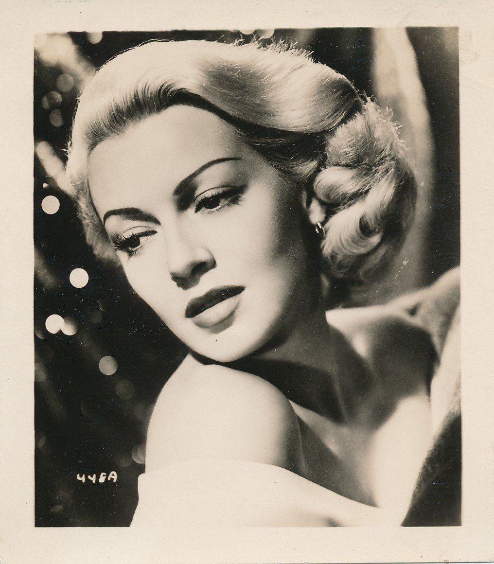 Lana Turner | Vintage Black and White Photograph | Golden Age of Hollywood Celebrity Head Shot | Great for Scrapbook or Art Project #hollywoodgoldenage Gorgeous vintage black and white publicity head shot of Lana Turner. Most likely taken around the late 1930s or early 1940s. I really enjoyed her performances in Love Finds Andy Hardy and Ziegfeld Girl but she was fabulous in so many other films, including The Postman Always Rings Twice. This photo measures approximately 4 high x 3 1/2 wide and #hollywoodgoldenage