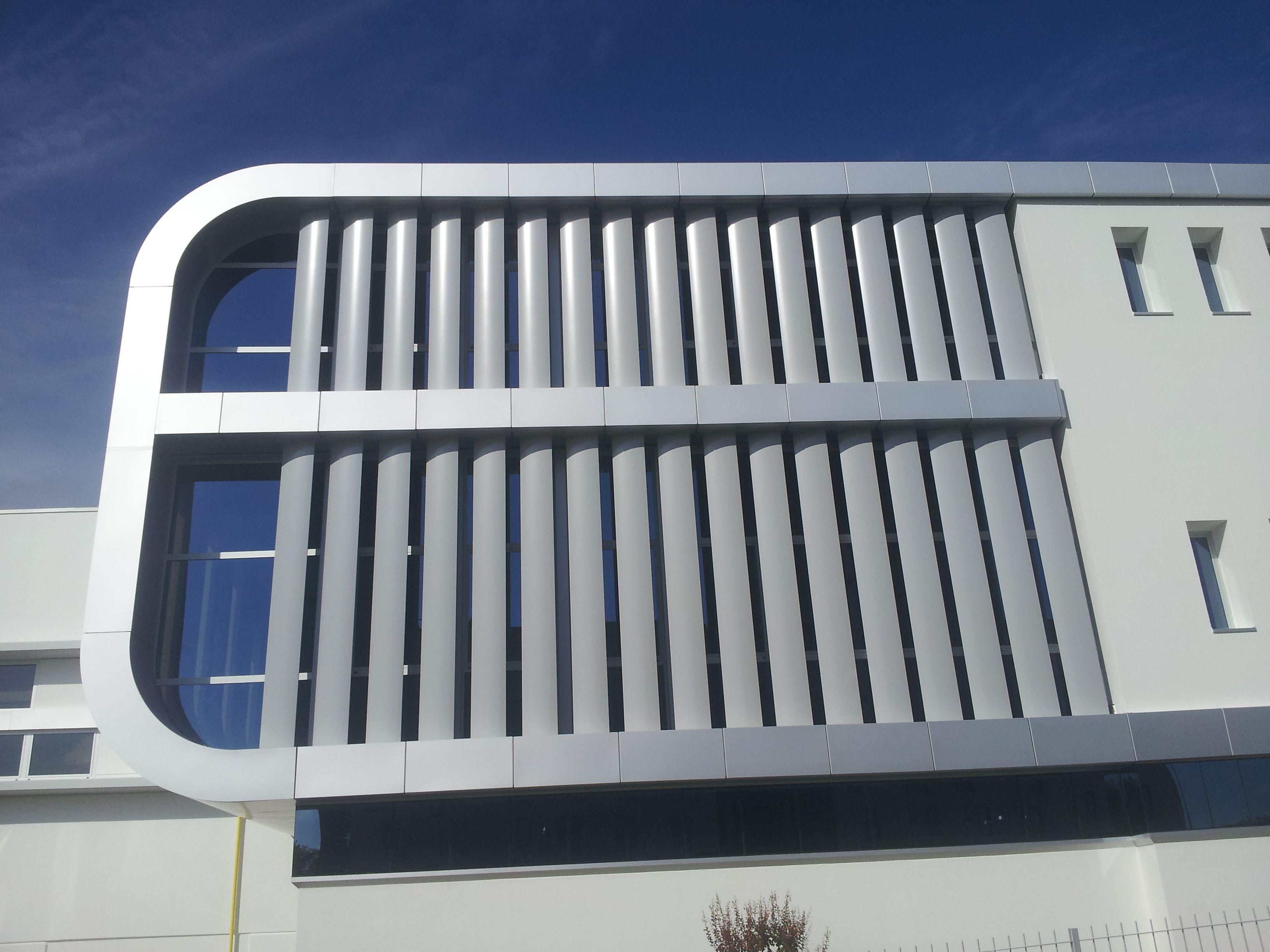 Stabilimento lavorazione materie plastiche facciata continhua