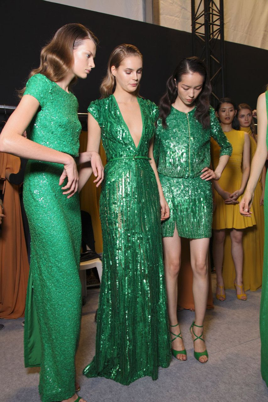 green with envy. middle dress please.
