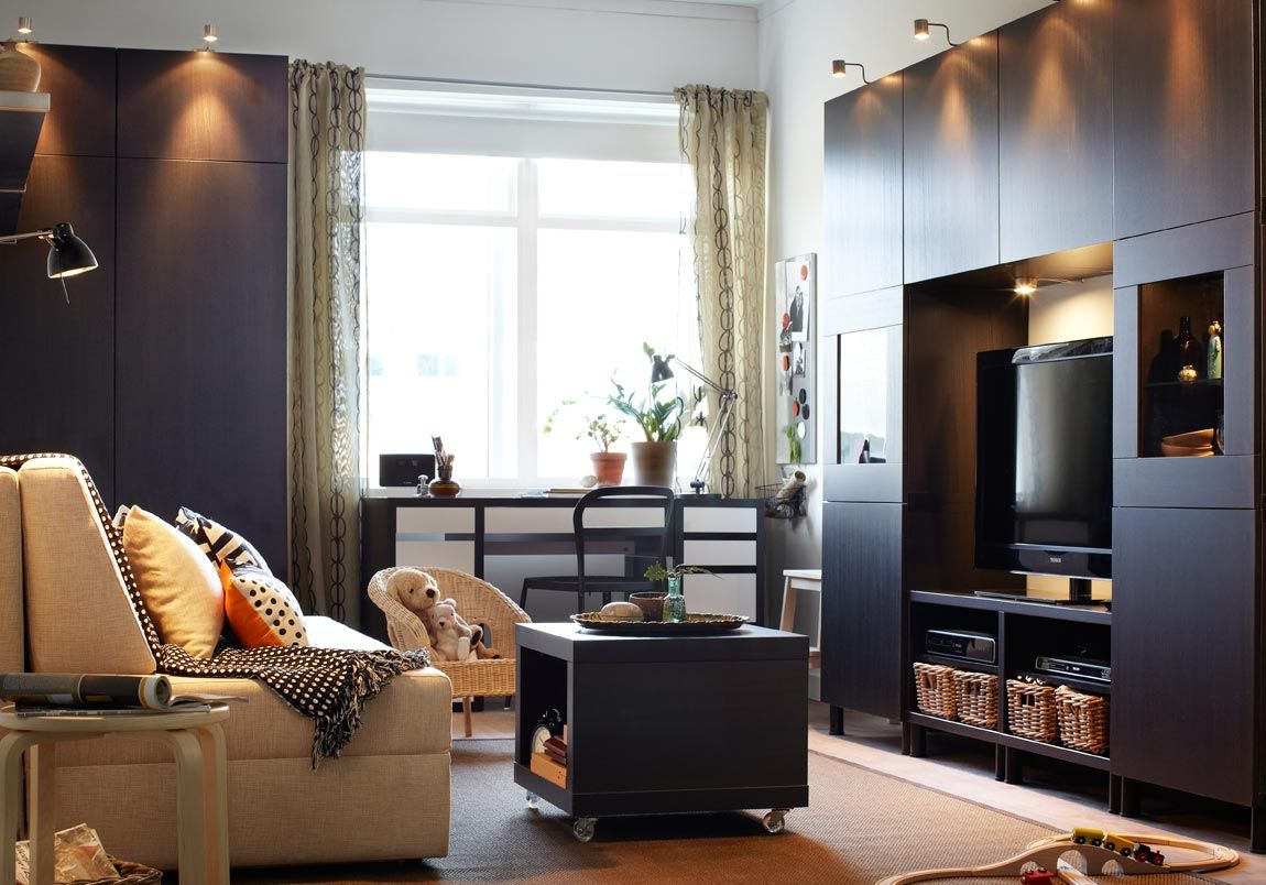Adorable IKEA Living Room Design Ideas : Chic White Wall IKEA Living Room  With Small Wheeled Table And Dark Wood TV Cabinet