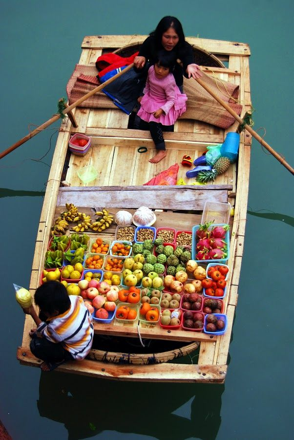 Floating Market in Cat Ba, Vietnam. Cat Ba is the largest of the 366 islands that comprise the Cat Ba Archipelago, which makes up the southeastern edge of Ha Long Bay in Northern Vietnam.