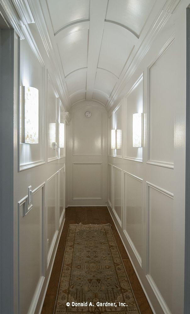 This Hallway Is Striking With Intricate Trim Work Barrel