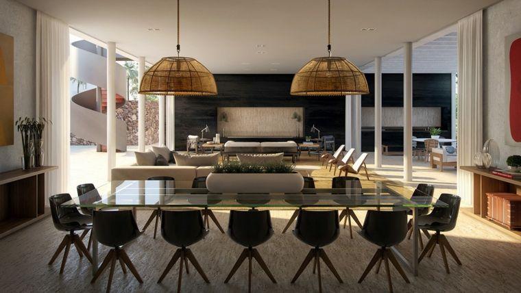 tavolo da pranzo in cristallo con tante sedie di design ...