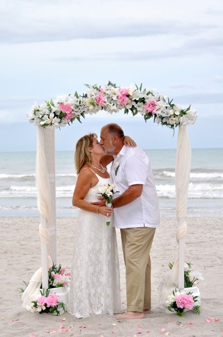 Married under a beautiful wedding arch on the beach in