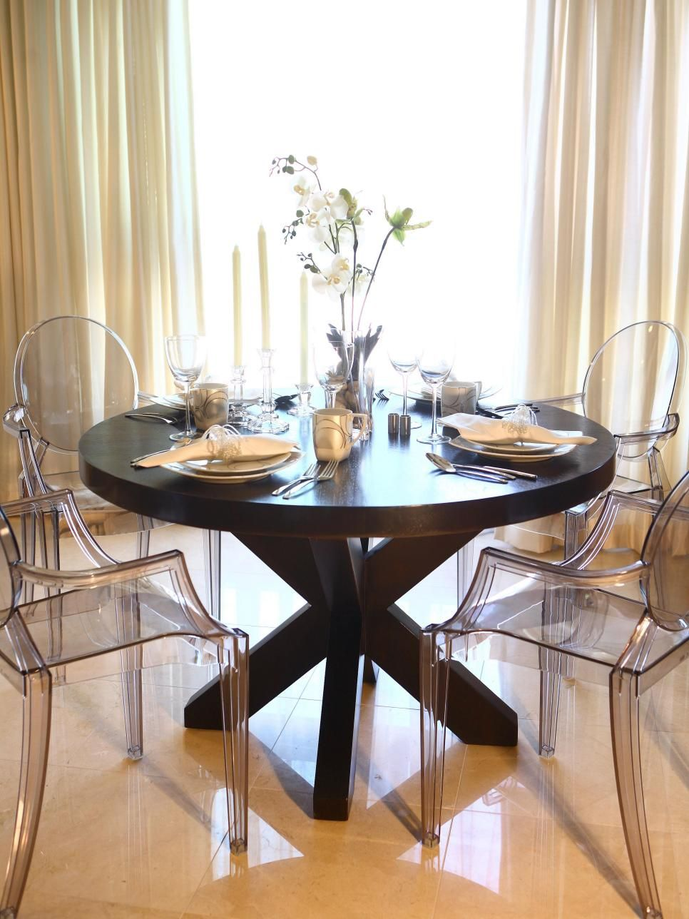 This Elegant Dining Room Features A Large Round Wood Dining Table