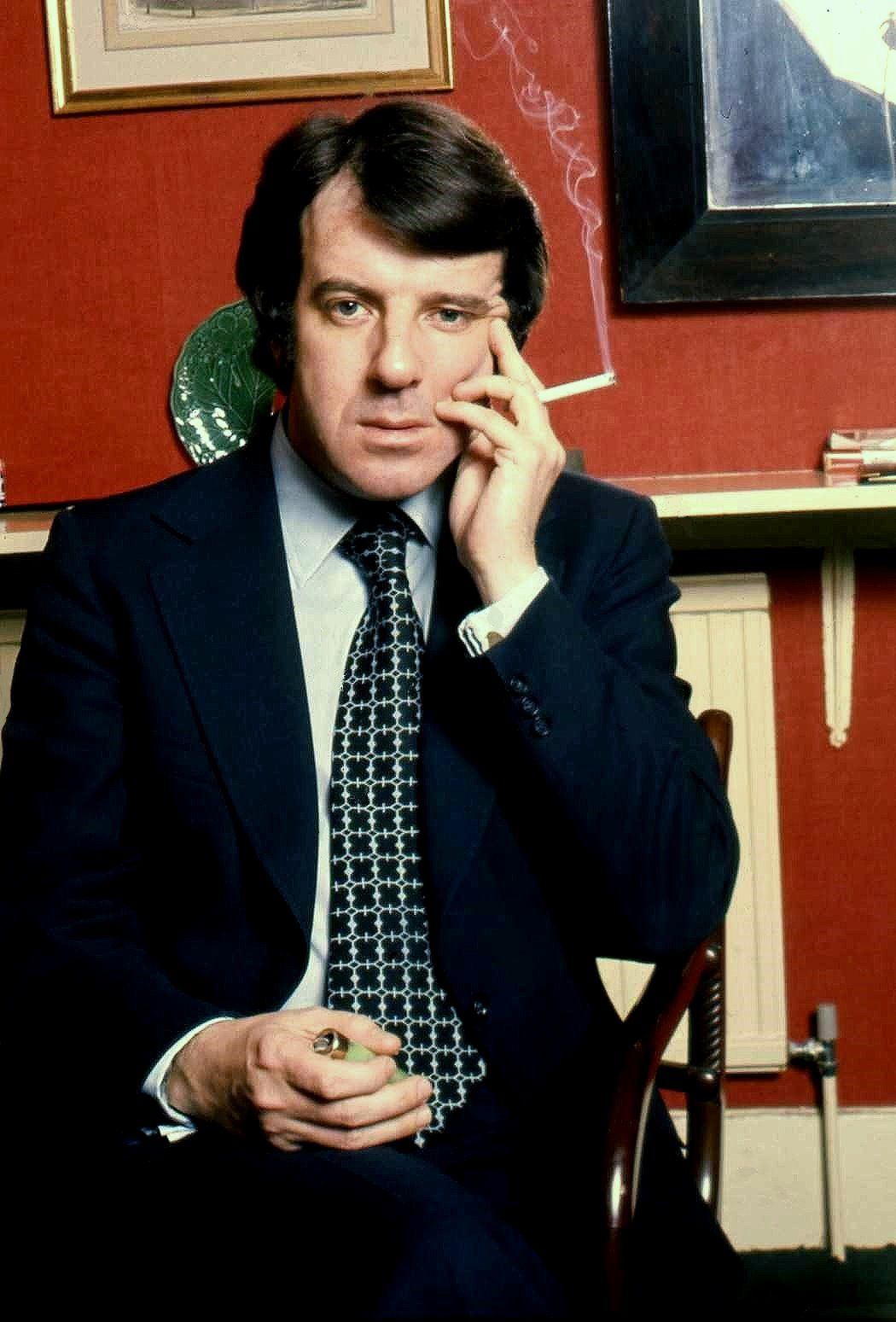 Russell Harty (5 September 1934 – 8 June 1988) was a British television presenter of arts programmes and chat shows.  Portrait of Russel Harty at his home Lexham Gardens Kensington London, 1973, by Allan Warren.