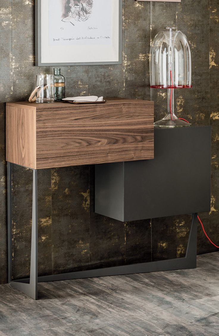 Portos bar unit in canaletto designed by andrea lucatello for cattelan italia it is elegant modern and perfect for small spaces
