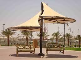 اعرف الان كل المميزات والاشكال الجديدة من مظلات بافضل الديكورات Http Www Swateer Pvc Com Patio Patio Umbrella Outdoor Decor