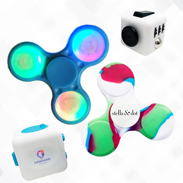 Fidget toys are the cool new way to promote your brand! To order, contact Liz at Liz@trophiesinc.com! #promotional #product #fidgetcube #fidgetspinner #fidgettoys #gifts #corporategifts #gadget #toy #executivetoy #trending