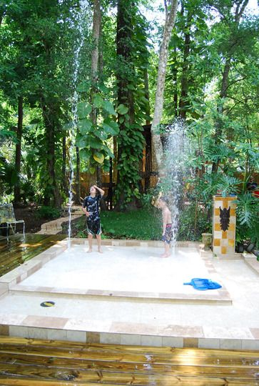 A back yard splash pad made out of beautiful (non slippery) Travertine tiles