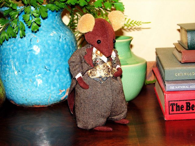 I came across a book for making Brambly Hedge mice from felt.  Instead of using felt, I created a little wedding party of mice from faux suede. I scavenged delicate little fabrics from here and there.  This is the Groom in his wool herringbone tuxedo and silk vest.