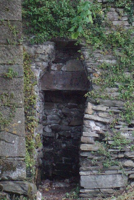 coffin shaped hole for pauper burials youghal town wall an empty