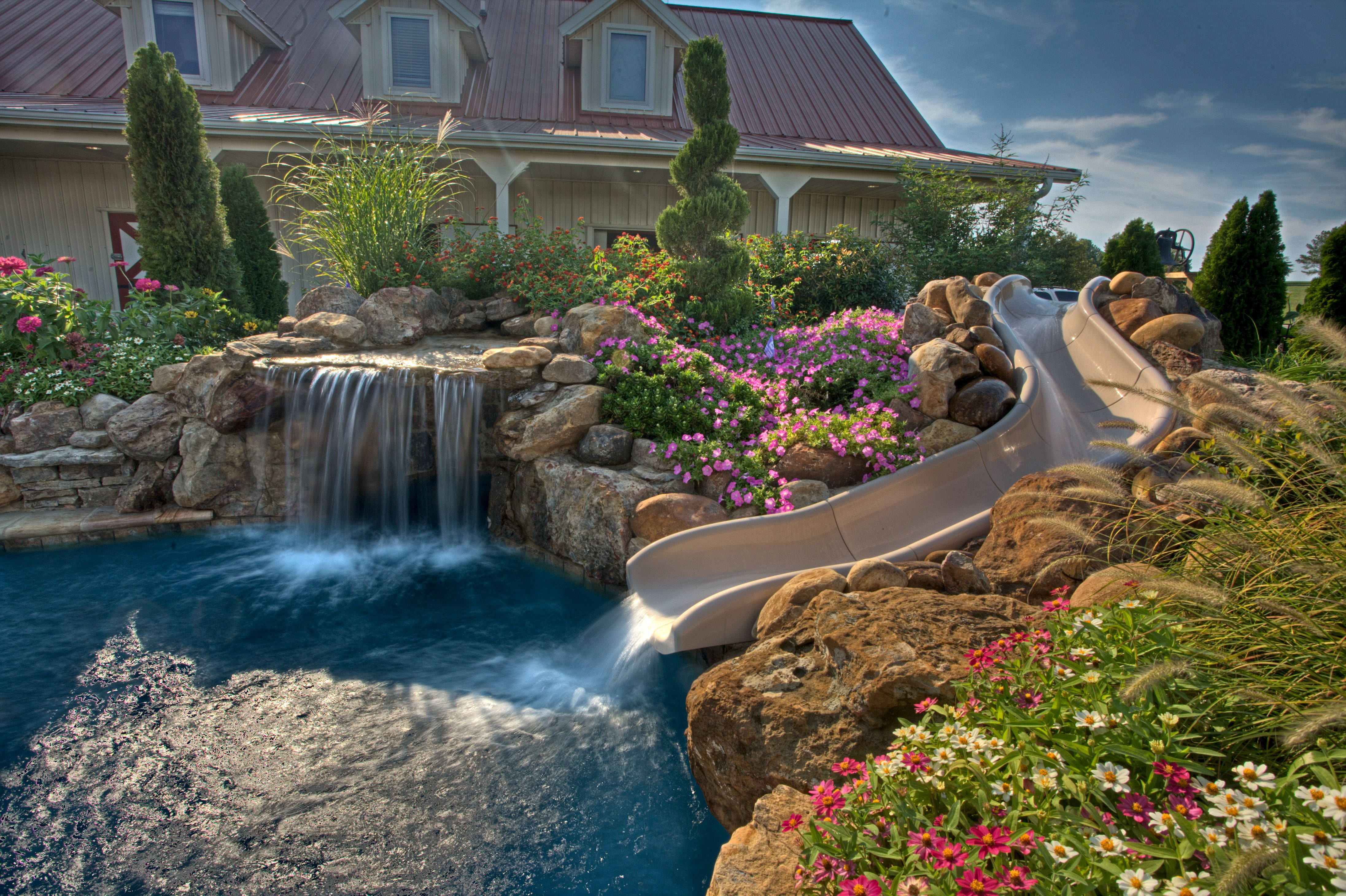 Natural Style Swimming Pool With Waterfall And Raised Spa And