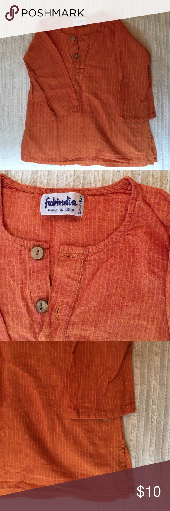 Tunic orange stripes shirt The perfect tunic to add to your little ones wardrobe. Lovely wooden buttons accent. Fabric is 100% cotton. Length 15 inches, chest 11 inches. Size says 1 - 2 years. Shirts & Tops Blouses