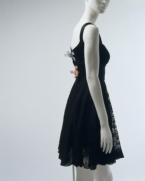 Black silk cocktail dress with pink and blue lace-up back (back), by Gianni Versace, Italian, fall/winter 1991-92.