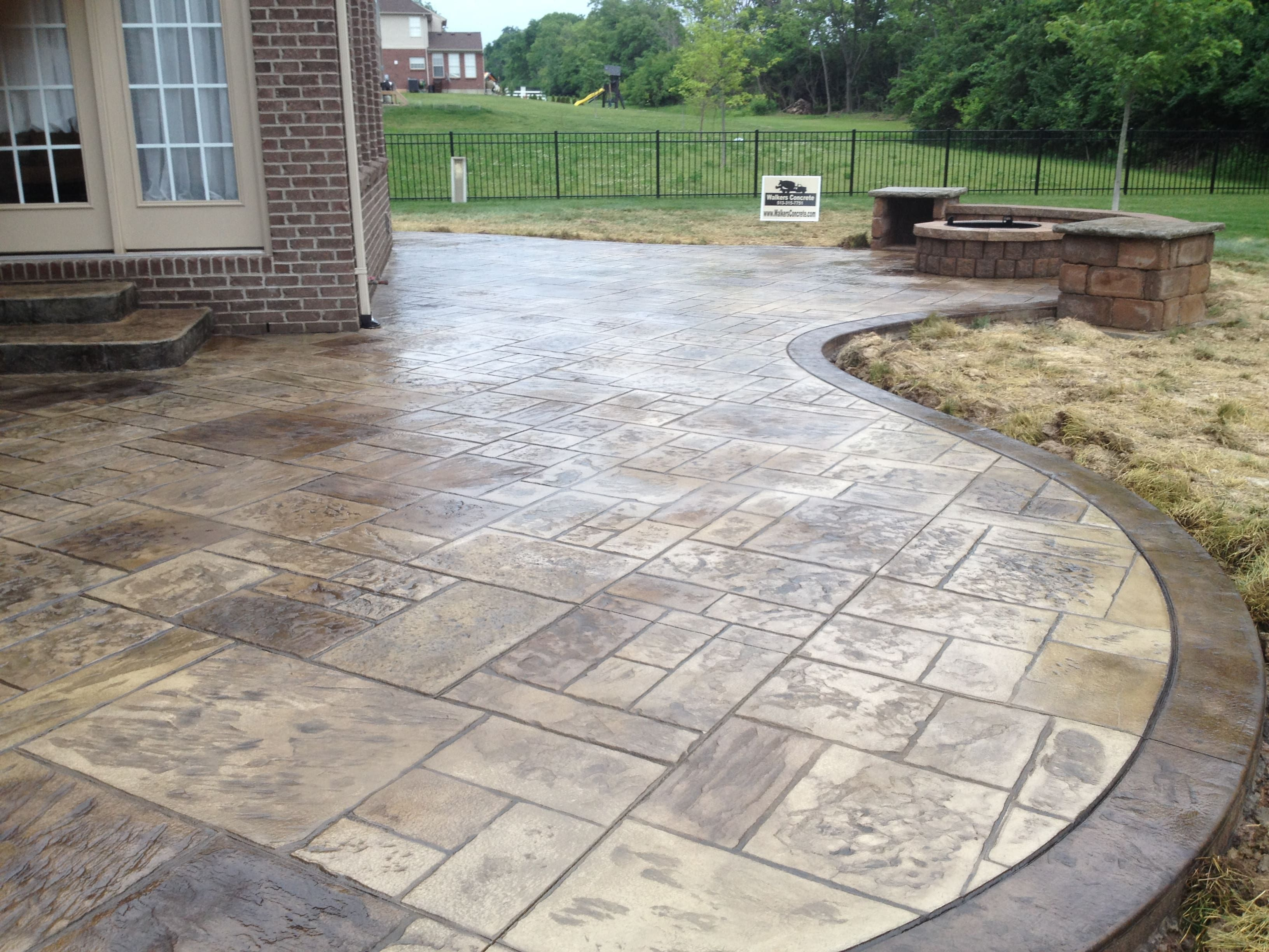 Decorative Concrete Patio with Seating Wall, Columns and Fire Pit
