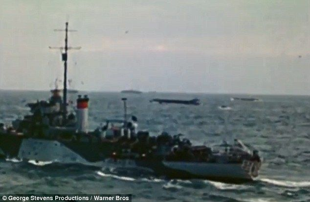 Might: British warships escort their landing craft to the three beaches they and the Canad...