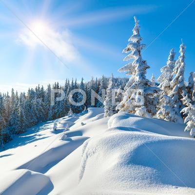 Snowdrifts on winter snow covered mountainside and sun Stock Photos ,#snow#covered#Snowdrifts#winter