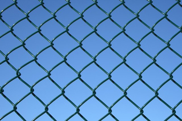 How To Stretch A Chainlink Fence Hunker Chain Link Fence Chain Link Dog Kennel Cheap Dog Kennels