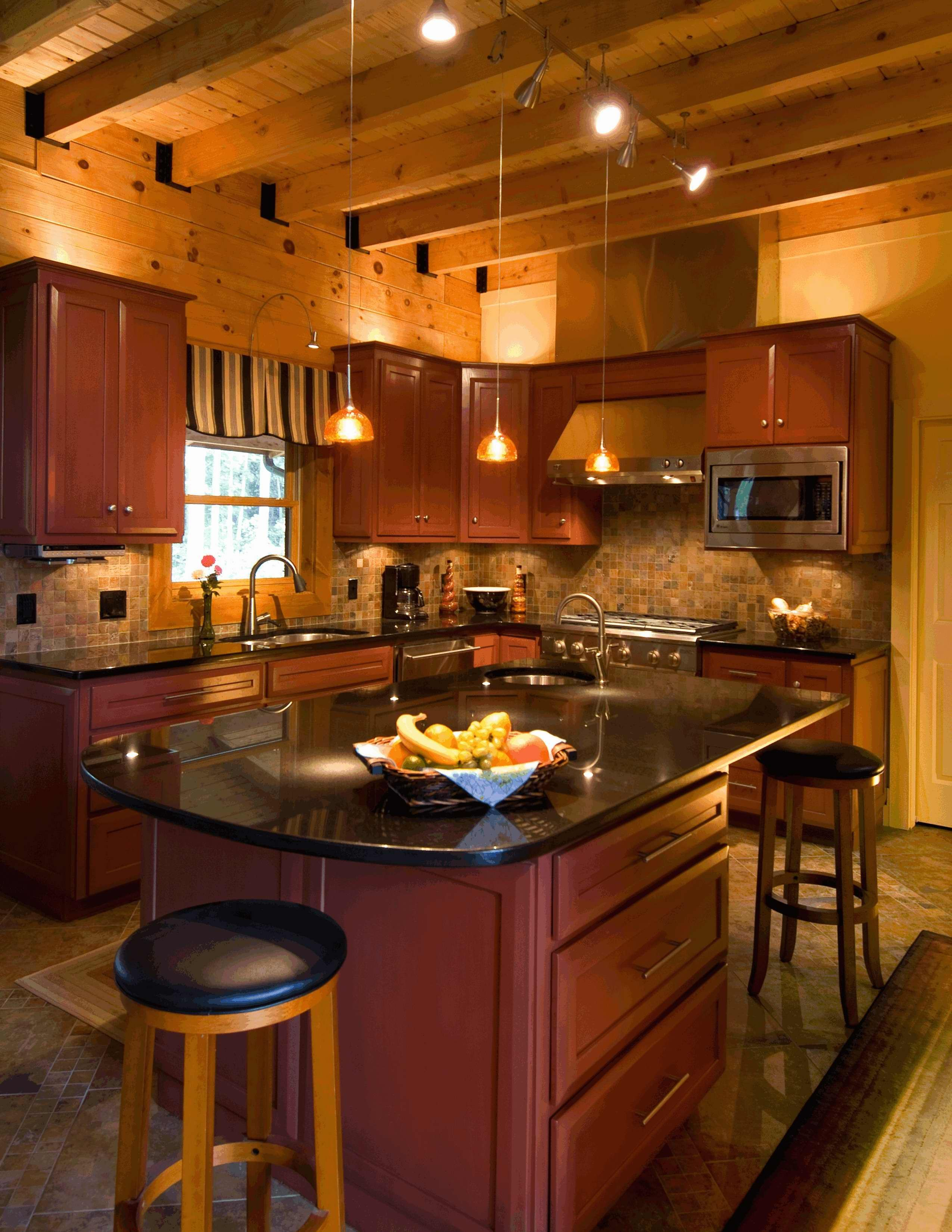 Timber frame beam ceiling, custom cherry cabinets and black ... on