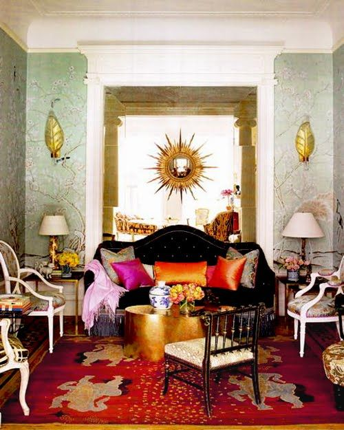Living room with gypsy decor style black couch and colorful pillows gold hammered coffee table queen anne arm side chair floral wallpaper also gorgeous interior pinterest modern boho rh