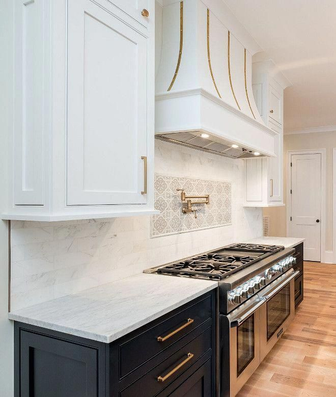 dark lower cabinets and white upper cabinets to create two ...