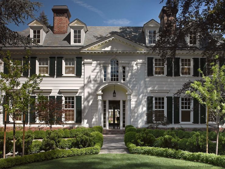 Grand Colonial Style Home Exterior With White Paneling Column Detail And Dental Moldings Black Fron Traditional Home Exteriors House Exterior Colonial House