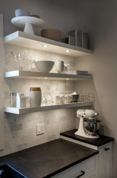 white kitchen floating shelves marble subway tile soapstone counter under shelf lights