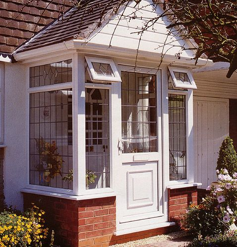 Small Enclosed Front Porch Entry: Entry Way- Cool Windows